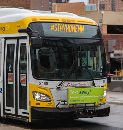 Metro Transit bus with #stayhomemn sign